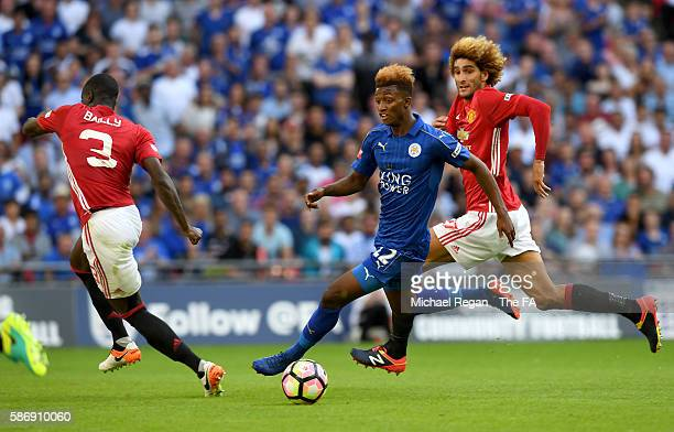 Demarai Gray of Leicester City runs at Eric Bailly of Manchester United during The FA Community Shield match between Leicester City and Manchester...