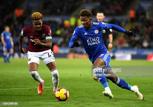 Demarai Gray of Leicester City runs with the ball under pressure from Grady Diangana of West Ham United during the Premier League match between...