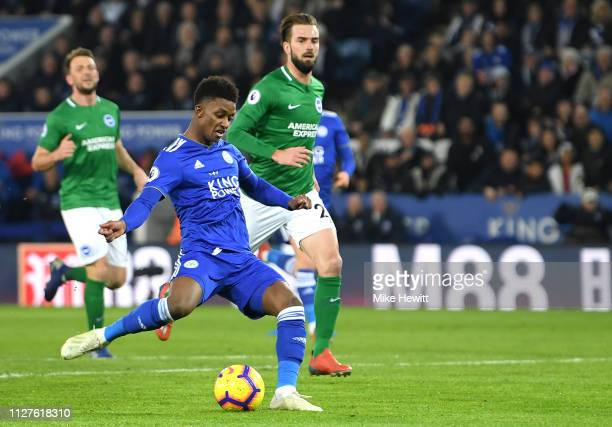 Demarai Gray of Leicester City scores his team's first goal during the Premier League match between Leicester City and Brighton Hove Albion at The...