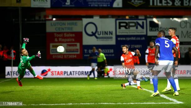 Demarai Gray of Leicester City scores his teams first goal during the Carabao Cup Third Round match between Luton Town and Leicester City at...