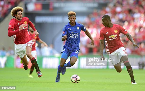 Demarai Gray of Leicester City skip past Eric Bailly of Manchester United and Marouane Fellaini of Manchester United during The FA Community Shield...