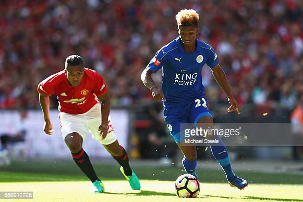 Demarai Gray of Leicester City skips past Antonio Valencia of Manchester United during The FA Community Shield match between Leicester City and...