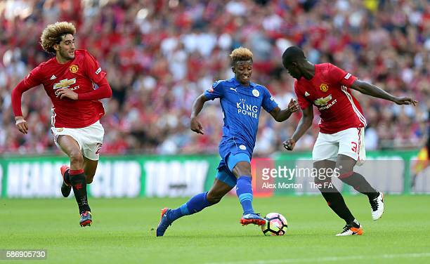 Demarai Gray of Leicester City skips past Eric Bailly of Manchester United during The FA Community Shield match between Leicester City and Manchester...