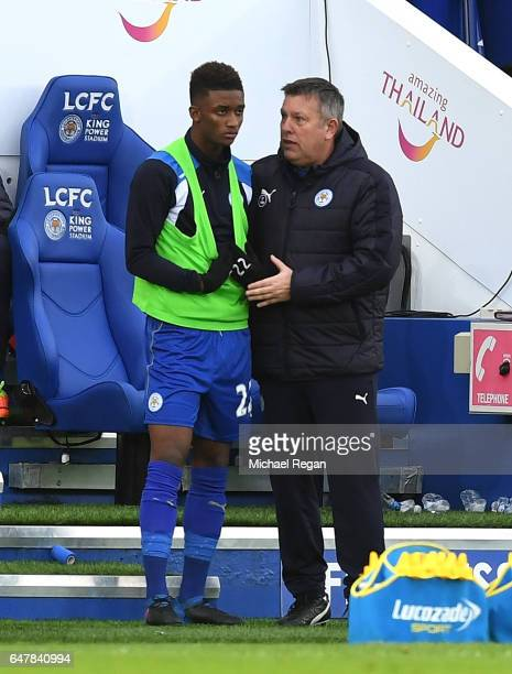 Demarai Gray of Leicester City speaks to Craig Shakespeare caretaker manager of Leicester City during the Premier League match between Leicester City...