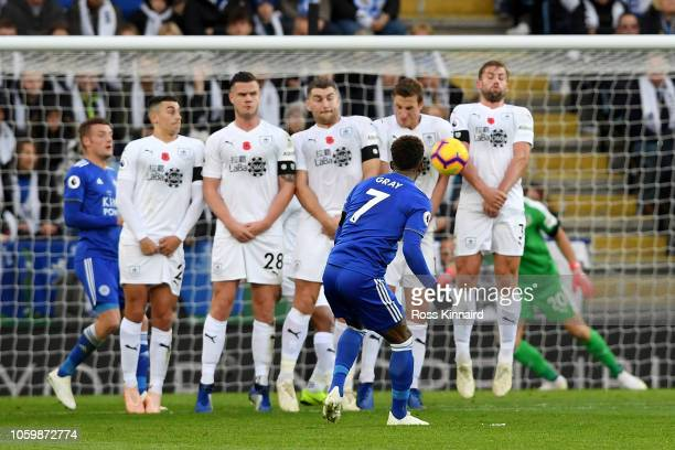 Demarai Gray of Leicester City takes a free kick which is blocked during the Premier League match between Leicester City and Burnley FC at The King...