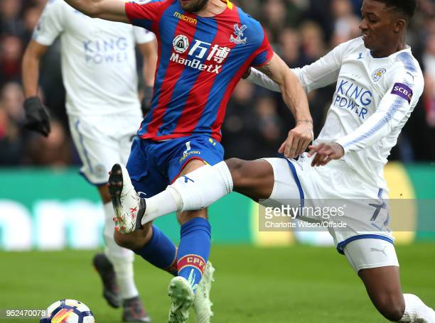 Demarai Gray of Leicester stretches across Yohan Cabaye of Crystal Palace during the Premier League match between Crystal Palace and Leicester City...