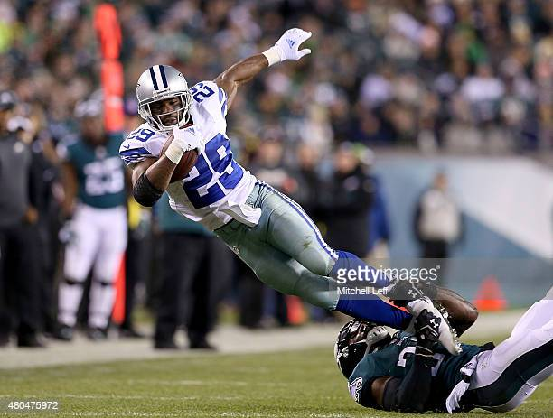 DeMarco Murray of the Dallas Cowboys is tackled during the game against the Philadelphia Eagles at Lincoln Financial Field on December 14, 2014 in...