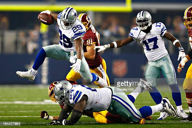 DeMarco Murray of the Dallas Cowboys jumps over a tackle during the first half of a game against the Washington Redskins at ATT Stadium on October 13...