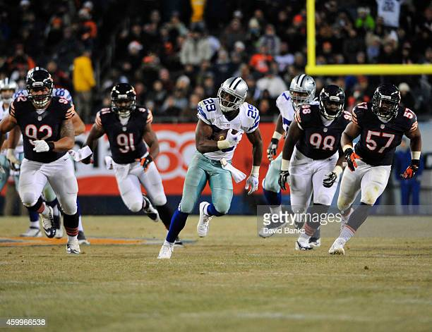 DeMarco Murray of the Dallas Cowboys runs against the Chicago Bears during the fourth quarter on December 4, 2014 at Soldier Field in Chicago,...