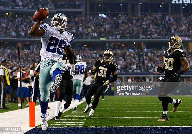 DeMarco Murray of the Dallas Cowboys runs for a touchdown against the New Orleans Saints in the first half at AT&T Stadium on September 28, 2014 in...