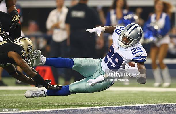 DeMarco Murray of the Dallas Cowboys scores a touchdown against Corey White of the New Orleans Saints at AT&T Stadium on September 28, 2014 in...