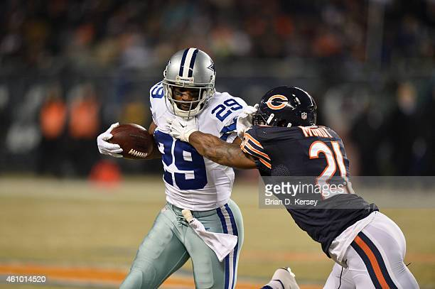 DeMarco Murray of the Dallas Cowboys stiffarms Ryan Mundy of the Chicago Bears during the first quarter at Soldier Field on December 4 2014 in...