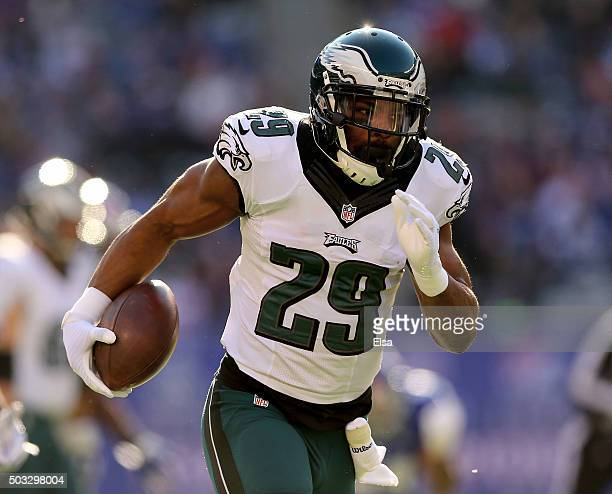 DeMarco Murray of the Philadelphia Eagles carries the ball in for a touchdown in the first quarter against the New York Giants at MetLife Stadium on...