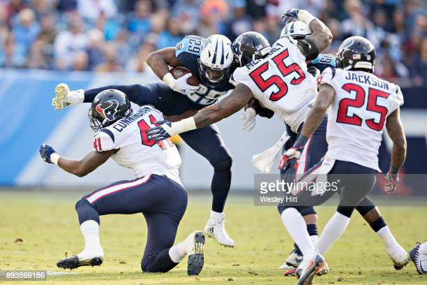 DeMarco Murray of the Tennessee Titans attempts to jump over Zach Cunningham of the Houston Texans at Nissan Stadium on December 3, 2017 in...