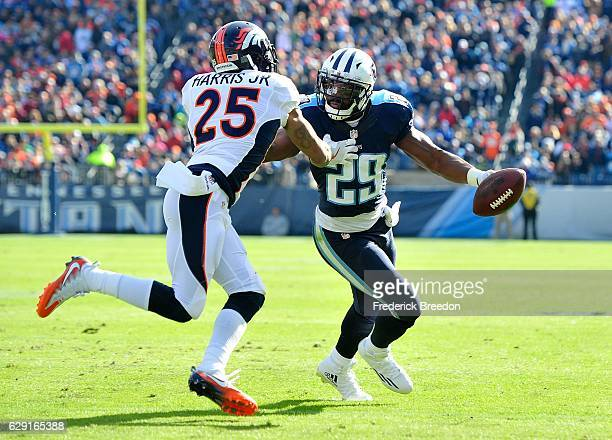 DeMarco Murray of the Tennessee Titans carries the ball against Chris Harris Jr #25 of the Denver Broncos during the second half at Nissan Stadium on...