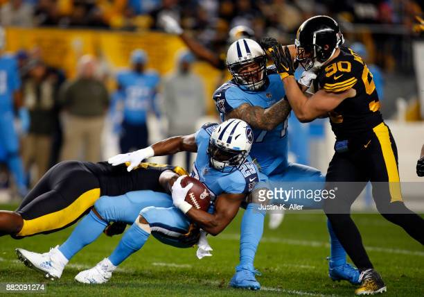 DeMarco Murray of the Tennessee Titans in action against Vince Williams of the Pittsburgh Steelers and TJ Watt of the Pittsburgh Steelers on November...