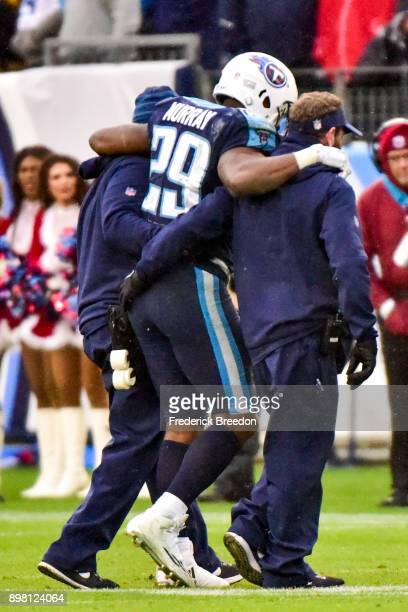 DeMarco Murray of the Tennessee Titans is helped off the field during the game against the Los Angeles Rams at Nissan Stadium on December 24, 2017 in...