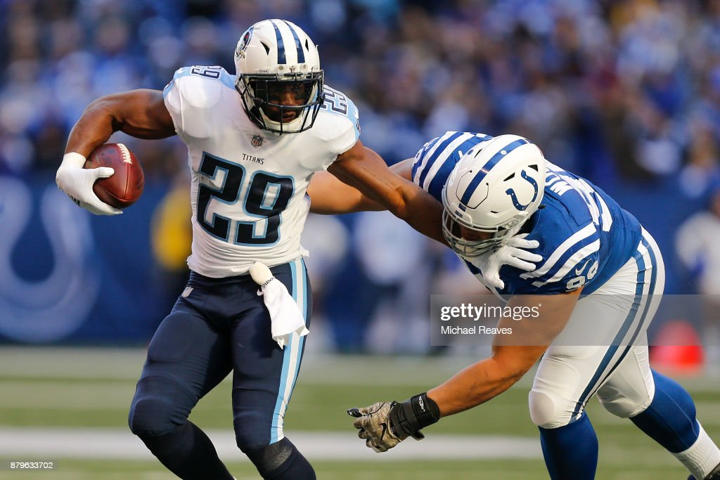 DeMarco Murray #29 of the Tennessee Titans pushes off a tackle from Al Woods #99 of the Indianapolis Colts during the first half at Lucas Oil Stadium on November 26, 2017 in Indianapolis, Indiana.