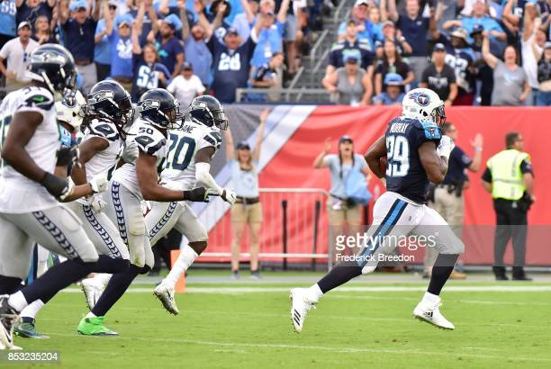 DeMarco Murray of the Tennessee Titans runs past a group of the Seattle Seahawks for a touchdown during the second half at Nissan Stadium on...