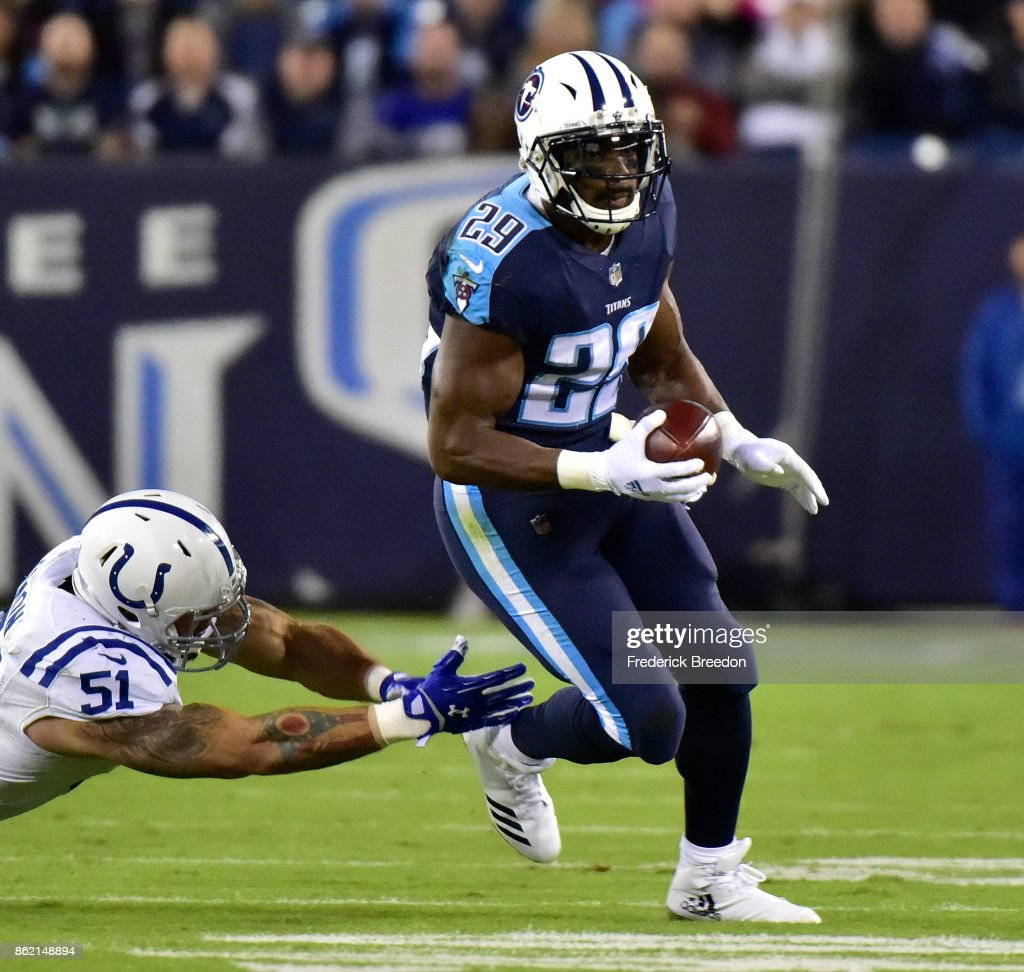 DeMarco Murray #29 of the Tennessee Titans rushes against John Simon #51 of the Indianapolis Colts during the first half at Nissan Stadium on October 16, 2017 in Nashville, Tennessee.