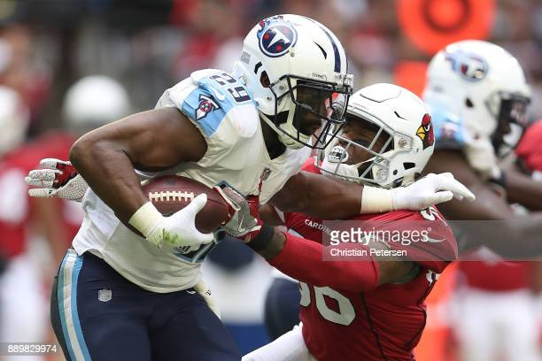 DeMarco Murray of the Tennessee Titans rushes the football against Budda Baker of the Arizona Cardinals at University of Phoenix Stadium on December...