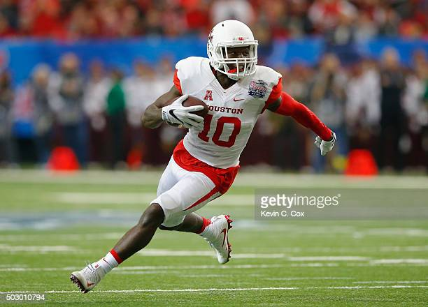 Demarcus Ayers of the Houston Cougars rushes against the Florida State Seminoles in the second quarter during the Chick-fil-A Peach Bowl at the...