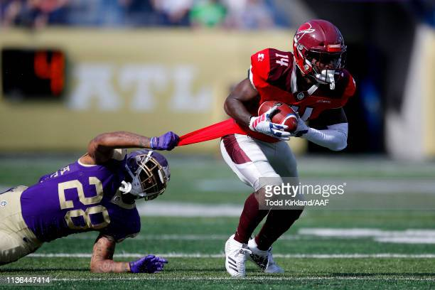 De'Marcus Ayers of the San Antonio Commanders escapes the tackle attempt of Louis Young of the Atlanta Legends during the first half in the Alliance...