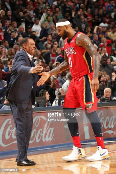 DeMarcus Cousins and Alvin Gentry of the New Orleans Pelicans shake hands during the game against the Milwaukee Bucks on December 13 2017 at Smoothie...
