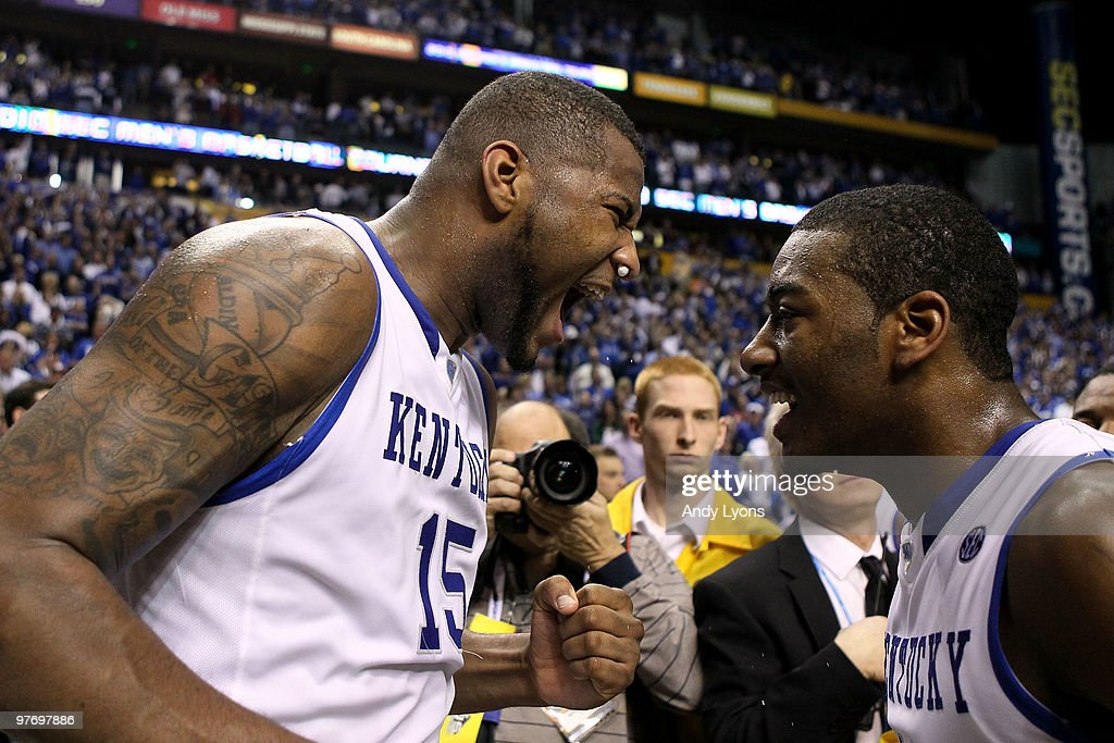 DeMarcus Cousins #15 and John Wall #11 of the Kentucky Wildcats celebrate after they won 75-74 in overtime against the Mississippi State Bulldogs during the final of the SEC Men's Basketball Tournament at the Bridgestone Arena on March 14, 2010 in Nashville, Tennessee.
