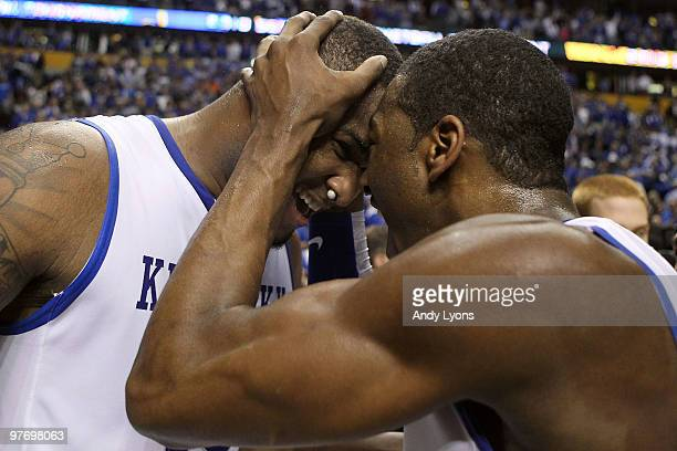 DeMarcus Cousins and John Wall of the Kentucky Wildcats celebrate after they won 75-74 in overtime against the Mississippi State Bulldogs during the...