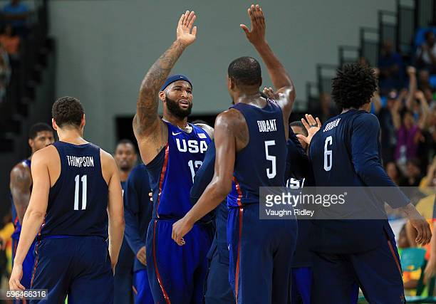 DeMarcus Cousins and Kevin Durant of the USA high five during the Men's Gold medal game between Serbia and the USA on Day 16 of the Rio 2016 Olympic...