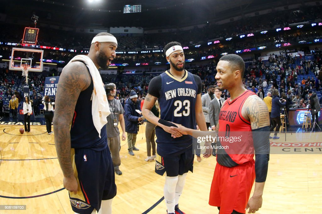 DeMarcus Cousins #0 Anthony Davis #23 of the New Orleans Pelicans and Damian Lillard #0 of the Portland Trail Blazers and talk after the game between the two teams on January 12, 2018 at the Smoothie King Center in New Orleans, Louisiana.