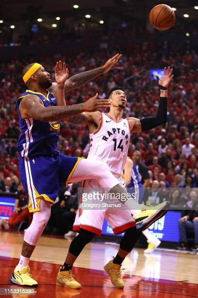 DeMarcus Cousins of the Golden State Warriors and Danny Green of the Toronto Raptors battle for the rebound in the first half during Game Two of the...