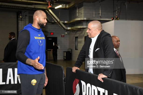 DeMarcus Cousins of the Golden State Warriors and ESPN writer Marc Spears talk before Game Three of the Western Conference Finals against the...