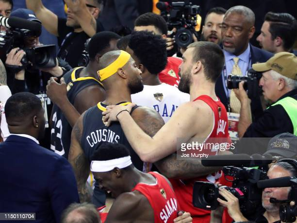 DeMarcus Cousins of the Golden State Warriors and Marc Gasol of the Toronto Raptors talk after a game during Game Six of the NBA Finals on June 13...
