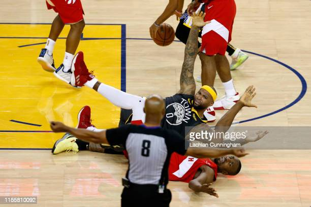 DeMarcus Cousins of the Golden State Warriors and Serge Ibaka of the Toronto Raptors battle for the ball in the second half during Game Six of the...