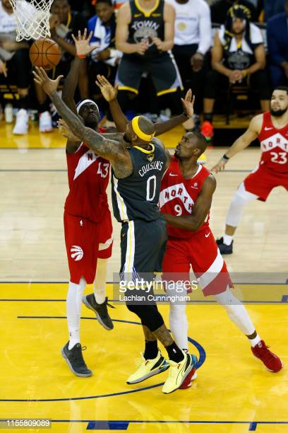 DeMarcus Cousins of the Golden State Warriors attempts a lay up against Pascal Siakam of the Toronto Raptors in the second half during Game Six of...