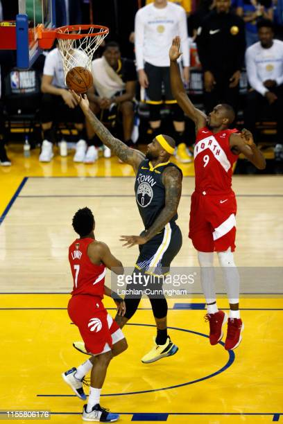 DeMarcus Cousins of the Golden State Warriors attempts a shot against Serge Ibaka of the Toronto Raptors in the second half during Game Six of the...