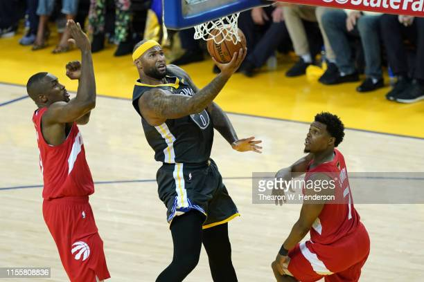 DeMarcus Cousins of the Golden State Warriors attempts a shot against Kyle Lowry of the Toronto Raptors in the second half during Game Six of the...