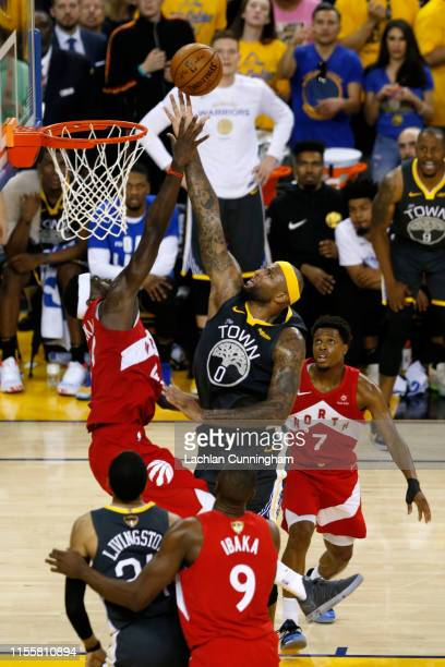 DeMarcus Cousins of the Golden State Warriors attempts a shot against the Toronto Raptors in the second half during Game Six of the 2019 NBA Finals...