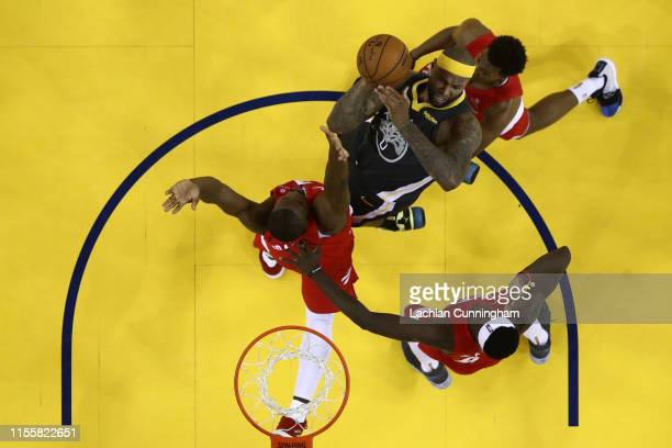 DeMarcus Cousins of the Golden State Warriors attempts a shot against the Toronto Raptors during Game Six of the 2019 NBA Finals at ORACLE Arena on...