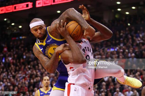 DeMarcus Cousins of the Golden State Warriors attempts to block a shot from Serge Ibaka of the Toronto Raptors in the second half during Game One of...
