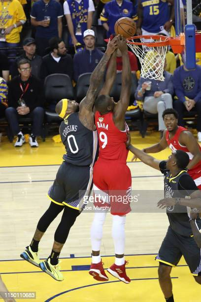 DeMarcus Cousins of the Golden State Warriors blocks the shot of Serge Ibaka of the Toronto Raptors during Game Six of the NBA Finals on June 13 2019...