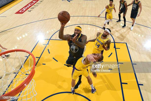 DeMarcus Cousins of the Golden State Warriors drives through the paint during the game against Michael Beasley of the Los Angeles Lakers on February...