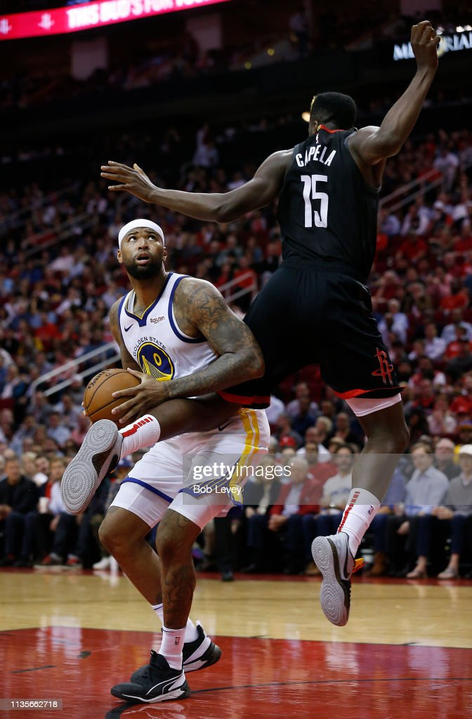 DeMarcus Cousins of the Golden State Warriors drives to the basket