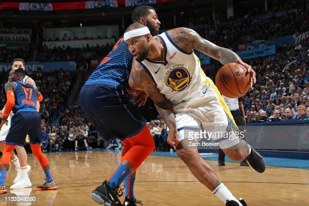 DeMarcus Cousins of the Golden State Warriors drives to the basket against the Oklahoma City Thunder on March 16 2019 at Chesapeake Energy Arena in...