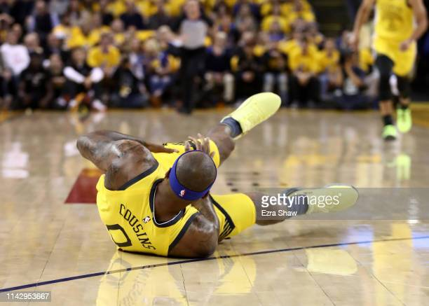 DeMarcus Cousins of the Golden State Warriors falls to the crowd after injuring himself against the LA Clippers during Game Two of the first round of...