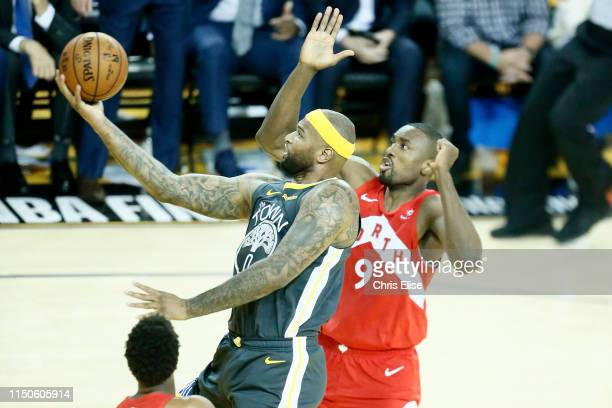DeMarcus Cousins of the Golden State Warriors goes to the basket against the Toronto Raptors during Game Six of the NBA Finals on June 13 2019 at...