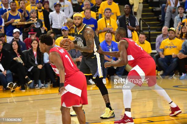 DeMarcus Cousins of the Golden State Warriors handles the ball against the Toronto Raptors during Game Six of the NBA Finals on June 13 2019 at...