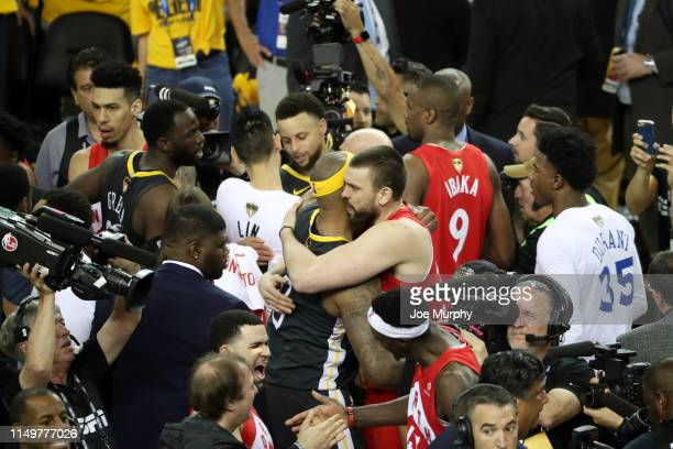 DeMarcus Cousins of the Golden State Warriors hugs Marc Gasol of the Toronto Raptors after the Toronto Raptors win the game and become the 2019 NBA...